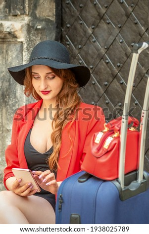 woman sits on suitcase in ancient city stock photo © ssuaphoto