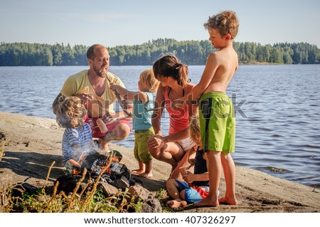 feed of the family, father, mother  and two suns over a green co Stock photo © meinzahn