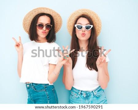 Two sexy girls posing on the beach  Stock photo © amok