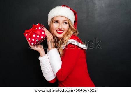 Beautiful mrs. Santa with Christmas decoration. Isolated on whit Stock photo © Nejron