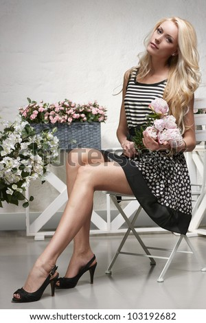 glamorous fashionable woman posing on luxury furniture beauty a stock photo © victoria_andreas