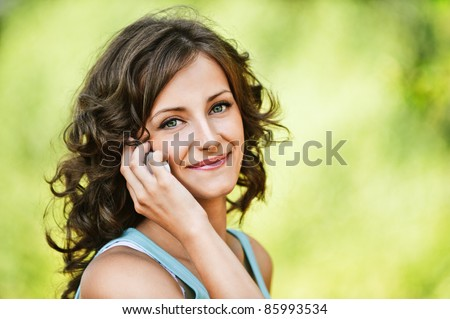 Portrait of beautiful dark-haired young woman, speaking on mobile phone  Stock photo © master1305