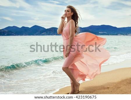 jovem · mulher · bonita · vestido · vermelho · blue · sky · nuvens · natureza - foto stock © victoria_andreas