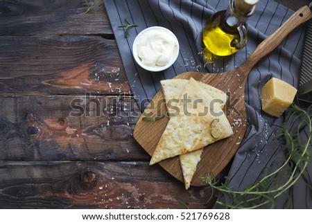 focaccia with olive oil parmesan cheese white sause and rosema stock photo © dashapetrenko