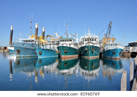 Black fishing boat is docked Stock photo © Klinker