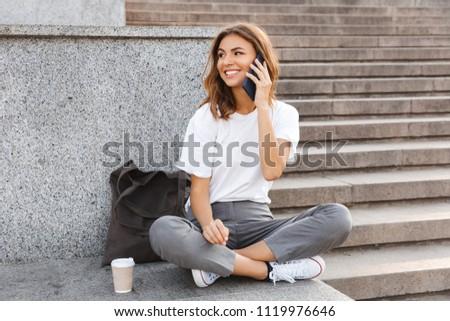 Photo belle jeune femme séance escaliers Grèce Photo stock © Massonforstock