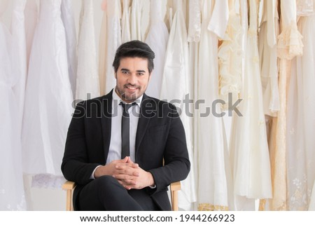 Portrait of happy bride holding bouquet while sitting on chair Stock photo © wavebreak_media