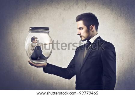 Człowiek biznesu szkła jar młodych smutne Zdjęcia stock © ichiosea