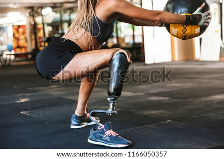 Portrait of european handicapped woman with prosthesis in tracks Stock photo © deandrobot