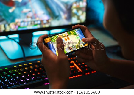 Portrait of professional gamer guy playing video games on comput Stock photo © deandrobot