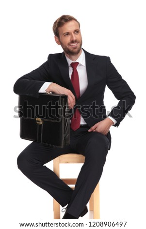 businessman holding his suitcase under his elbow looks to side Stock photo © feedough