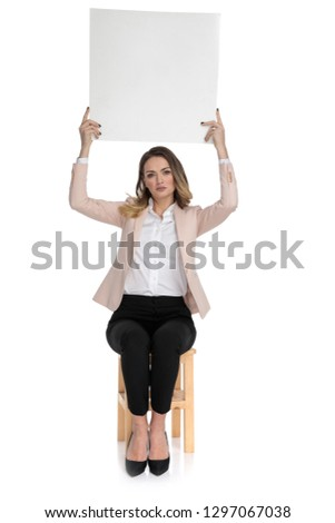 young businesswoman wearing high heels holds white board while s stock photo © feedough