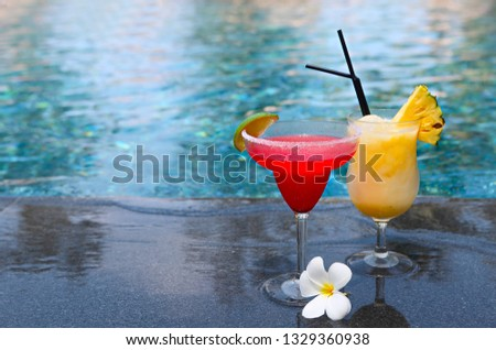 strawberry daiquiri and pina colada on the pool background trop stock photo © dashapetrenko