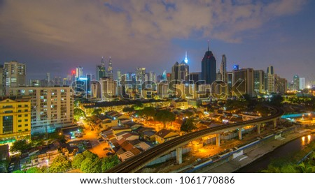 MALAYSIA, KUALA LUMPUR - April 2018: KL modern city skyline with Patronas Twin towers landmark Сток-фото © galitskaya