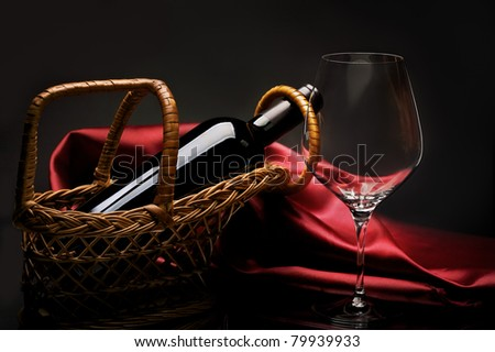 Bottle of red wine on red cloth with empty glass and dark grapes with corks and corkscrew inside vin Stock photo © DenisMArt