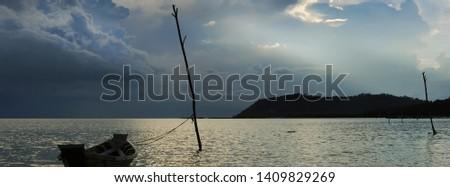 бурный облака морем одиноко лодка силуэта Сток-фото © amok