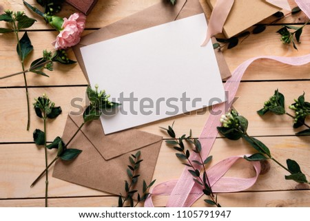 post card with pink carnation flowers in an envelope on a magenta background stock photo © artjazz