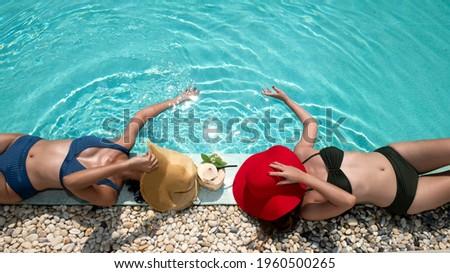 Piękna opalony kobieta czerwony bikini relaks Zdjęcia stock © boggy
