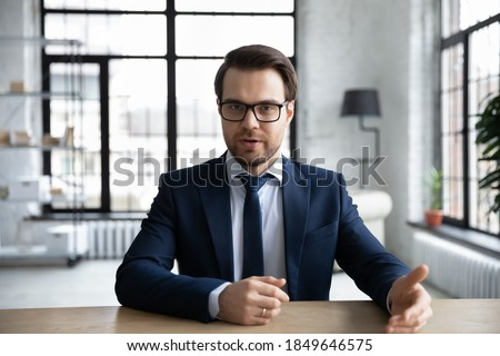 Image of happy man in formal wear and glasses talking on black s Stock photo © deandrobot