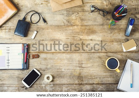 Notepad and stationery on wooden background. Planner for busines Stock photo © galitskaya