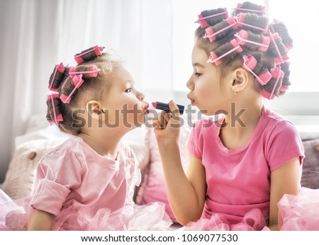 A Little girl having fun at home Stock photo © Lopolo