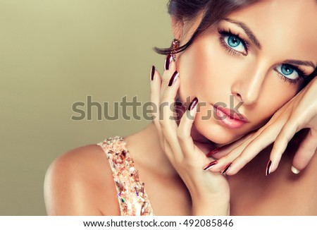 Beautiful model girl with pink metallic manicure on nails . Fashion makeup and cosmetics Stock photo © serdechny