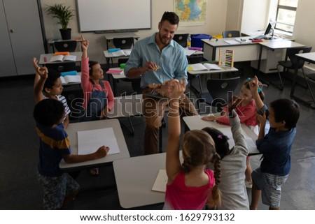 School kinderen handen leraar Stockfoto © wavebreak_media