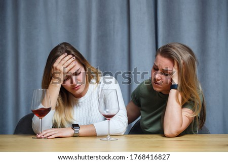 Laughing friends with champagne looking at one of girls telling funny stuff Stock photo © pressmaster