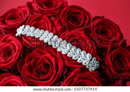 Luxury diamond jewelry bracelet and red roses flowers, love gift Stock photo © Anneleven