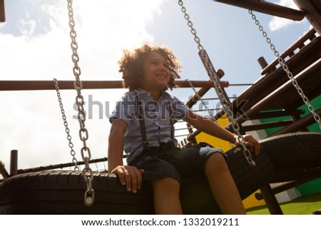Low angle view of a mixed -race  schoolgirl sitting on a basketball on basketball court at school Stock photo © wavebreak_media