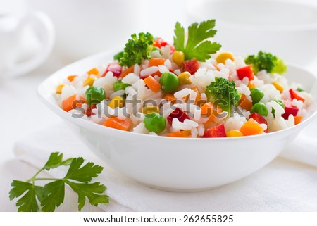 White bowl with boiled organic basmati vegetable rice on light stone background. Yellow corn and gre Stock photo © DenisMArt