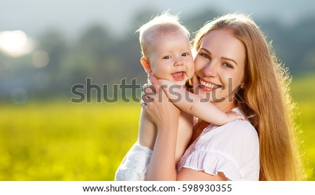Szczęśliwą rodzinę matka baby łące żółte kwiaty Zdjęcia stock © ElenaBatkova