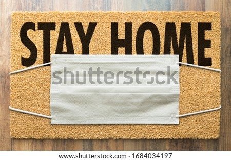 Welcome Mat With Medical Face Mask and #Stay At Home Text Isolat Stock photo © feverpitch