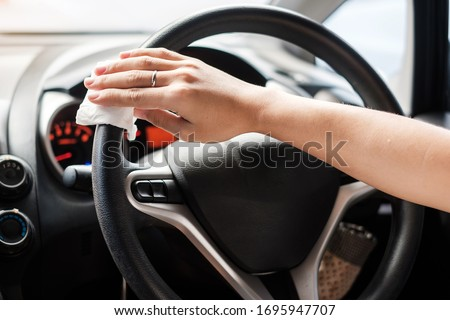 Cleaning Car With Sanitizer Wipe Against Virus Stock photo © AndreyPopov