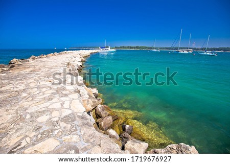 Town of Novigrad Istarski seafront breakwaer sailing destination Stock photo © xbrchx