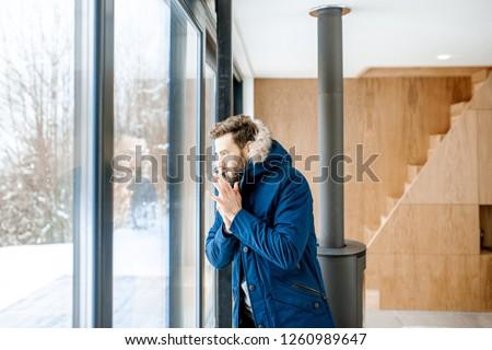 A man in a heated winter jacket Stock photo © galitskaya