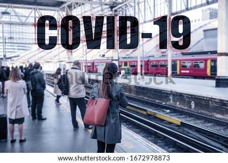 COVID-19 Text sign over travellers commuting at train station. Travel ban quarantine for public tran Stock photo © Maridav