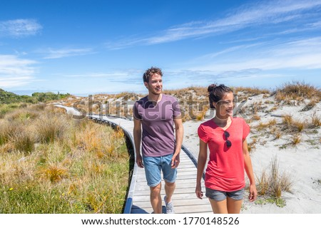 Couple walking on beach in New Zealand - people in Ship Creek on West Coast of New Zealand. Tourist  Stock photo © Maridav