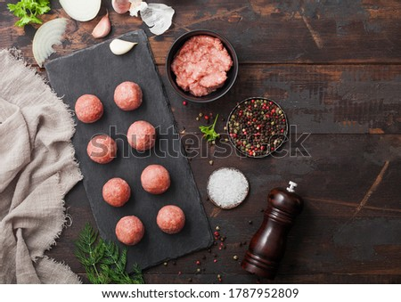 Fresh beef meatballs on stone board with pepper, salt and garlic on light background with dill,parsl Stock photo © DenisMArt