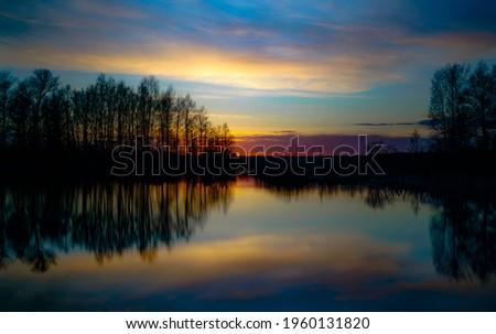 sunset lake stock photo © ptichka