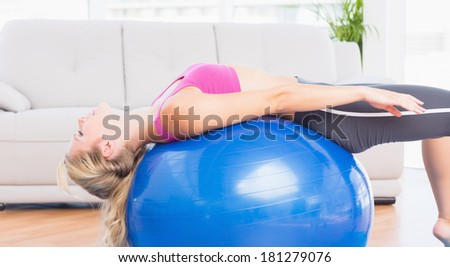 pretty blonde female stretching in the living room in her appartment stock photo © wavebreak_media
