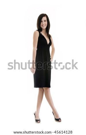 cute girl in black dress standing with crossed legs in studio Stock photo © epstock