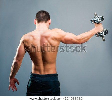 back view of young man with dumbbell against a white background stock photo © wavebreak_media