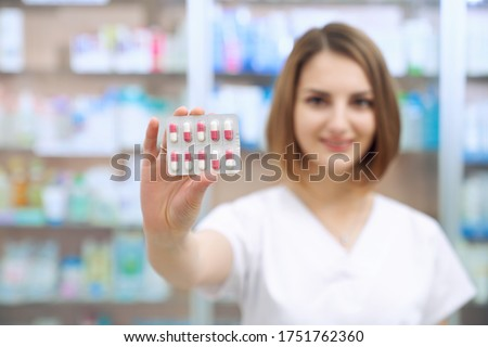 close up of a woman showing pills with the camera focus on her hand stock photo © wavebreak_media