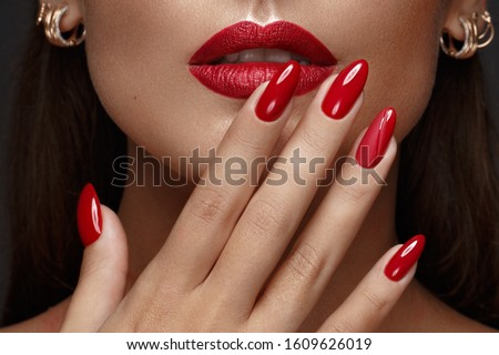 Fashion Portrait Of Beautiful Girl with red nails and lips. Vogu Stock photo © Victoria_Andreas
