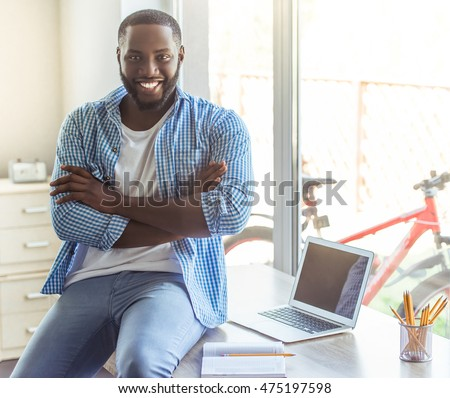 young Afro-American businessman working on his laptop and drinking his coffee Stock photo © photography33