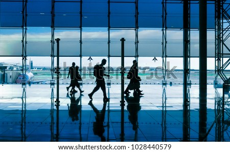 passengers are hurrying to the gate at the airport glass wall w stock photo © meinzahn