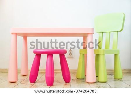 Small pink plastic stool for kids isolated on soft floor indoor  Stock photo © yanukit