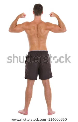 athletic man showing back and biceps muscles full length studio shot stock photo © amok