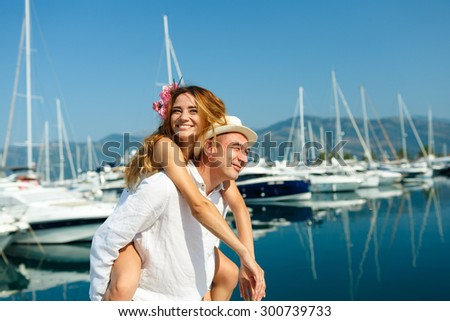 Attractive young couple walking alongside the marina with moored Stock photo © vlad_star